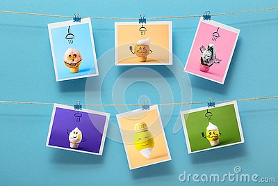Pictures with funny washing fruits hanging on a linen thread on stationery clips on a colored background, concept of cheerful mood