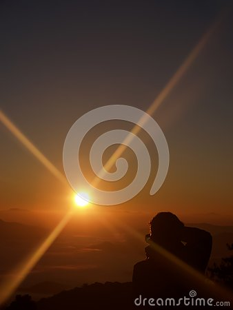 stock image of the beauty of the sunrises and the sky in the morning. and a photographer from the back was shooting. on the view point