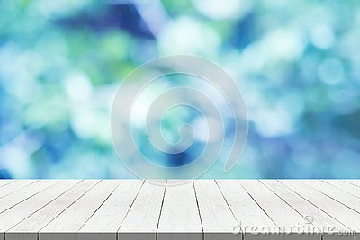 wood table top on nature blue blurred background for montage your product