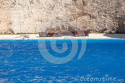 Navagio Beach in summer time with blue water of Greece , Zakintos