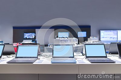 stock image of laptops in the modern electronics store. computer department in the technology store