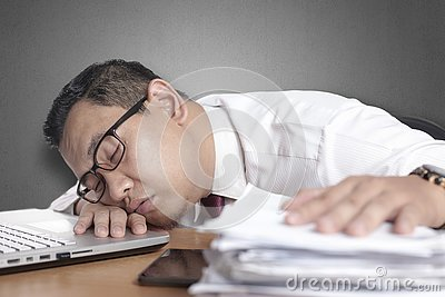Tired Sleepy Asian Businessman Having Overworked