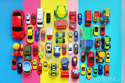 Many colored toy cars on multicolored background