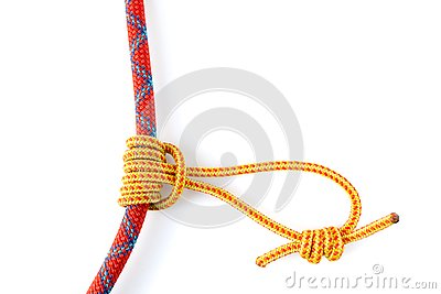 Prusik Knot or Triple Sliding Hitch formed with a 5mm yellow Prusik loop around a 9.8mm red climbing rope.