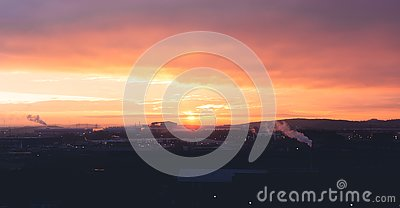 stock image of a beautiful orange and purple sunrise over sheffields industrial area