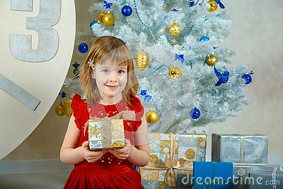 Girl Masha holding a box with a gift