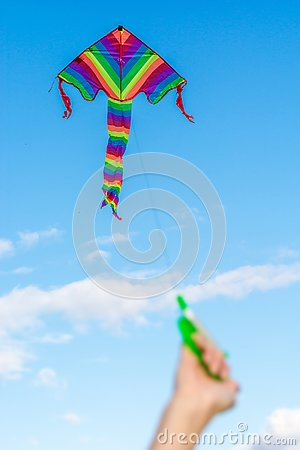 stock image of child makes kite rise in autumn