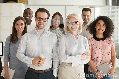 Smiling professional business leaders and employees group team portrait