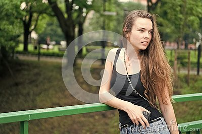 Girl walk park green nature background. Woman stop to enjoy nature peaceful environment during walk. Find time to relax