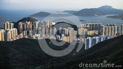 stock image of many buildings​ in mountianous ​and seaside location in hong​ kong​ island