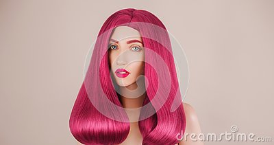 Redhead girl with shine hair. Pink coloration in salon. Long red wig. Shampoo treatment. Portrait of girl with perfect skin.
