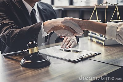 Good service cooperation of Consultation between a male lawyer and business woman customer, Handshake after good deal agreement,