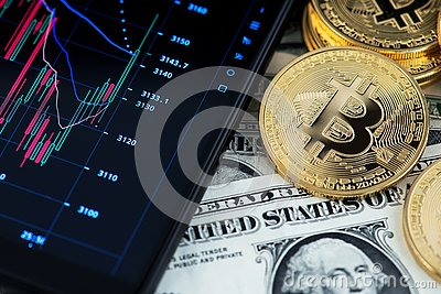 Bitcoin cryptocurrency and banknotes of one US dollar next to mobile phone showing candlestick chart.