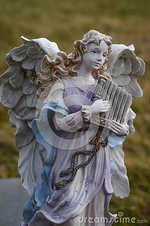 Angel Statue Playing a Harp Outside