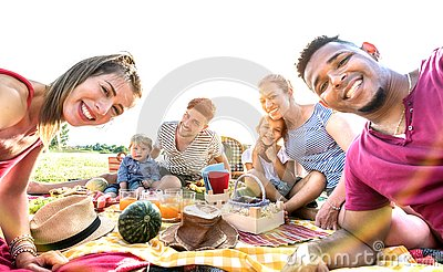 stock image of happy multiracial families taking selfie at pic nic garden party - multicultural joy and love concept with mixed race people