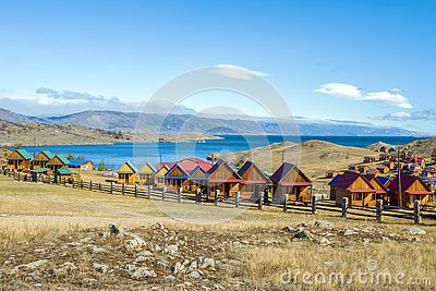 Beautiful view of the tourist centers and Kurkut Bay of Lake Baikal in September.