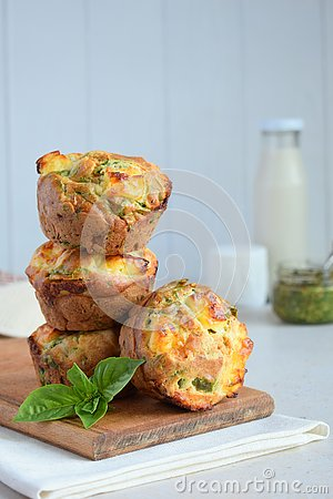 Freshly baked muffins with spinach, sweet potatoes and feta cheese on white background. Healthy food concept. Savory pastry