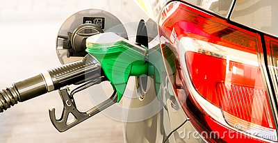 Car refuel at the petrol station. Concept photo for use of fuels gasoline, diesel, ethanol in combustion engines, air pollution