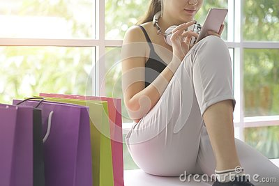 Caucasian girl shopping online with smartphone internet shop, e-commerce website on mobile