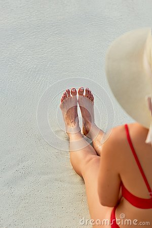 Women Beautiful Sexy Legs on the Beach. Skin care and Protection Sun. Spa Concep. Epilation Laser or Shaving Concept