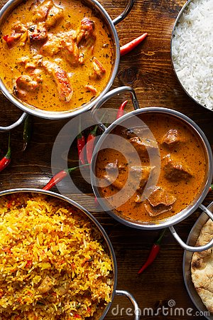 Assortment of indian curries and rice dishes