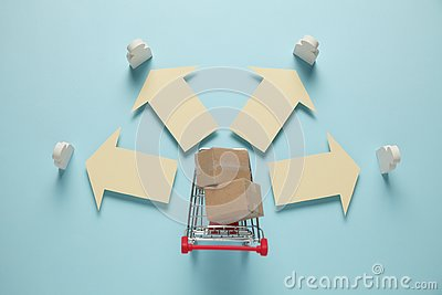 stock image of shopping cart with boxes. purchase and delivery of goods boxes from online stores, retail