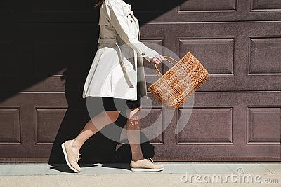stock image of girl walking with shopping bag in the street