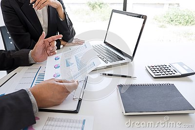 stock image of business team partner meeting working and negotiation analyzing with financial data and marketing growth report graph presentation