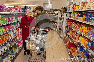 Woman and senior woman going for shopping in the supermarket