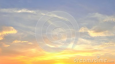 Beautiful panorama of orange and yellow cloudscapes at sunrise/sunset  on a blue sky in high resolution