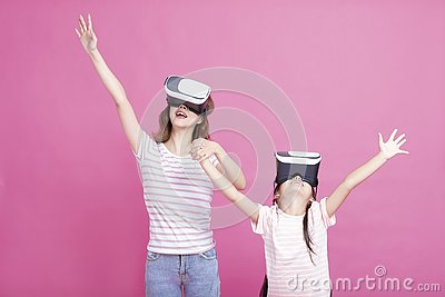 Mother and child playing together with virtual reality headsets