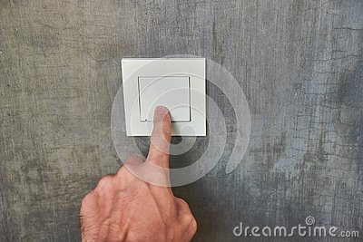 Man hand, to turn off the light, switch, front view