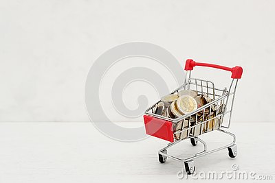 stock image of new thai baht coins in red miniature shopping cart.
