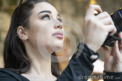 Attractive woman blogger making photos of foreign ancient architecture