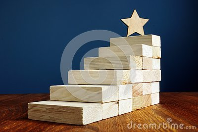 Goal setting and achievement. Star and stairs from wood