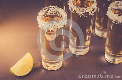 shots of tequila and pieces of lime/shots of tequila and pieces of lime. Toned and copyspace
