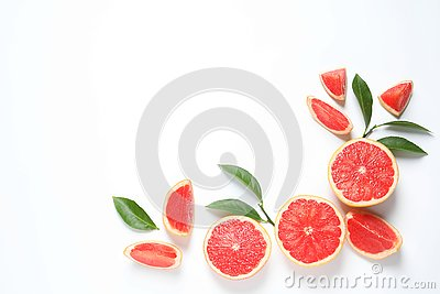 Frame made of grapefruits and leaves on white background, top view. Citrus fruits