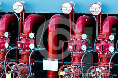 Main supply water piping in the fire extinguishing system. Fire sprinkler system with red pipes. Fire suppression. Manual valve