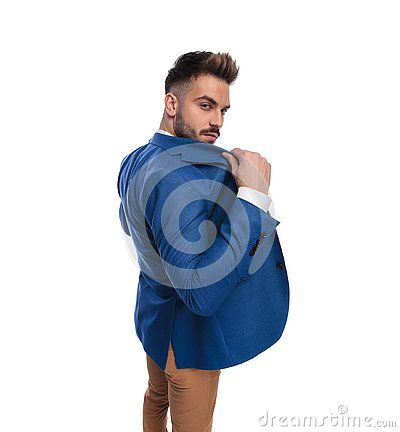 Back view of man opening or closing his lounge jacket