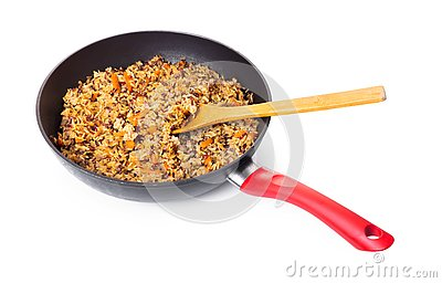 Assorted cooked rice with vegetables in a frying pan