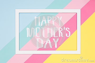 Happy Mothers Day abstract geometrical pastel blue, pink and yellow paper flat lay background. Minimalism greeting card.