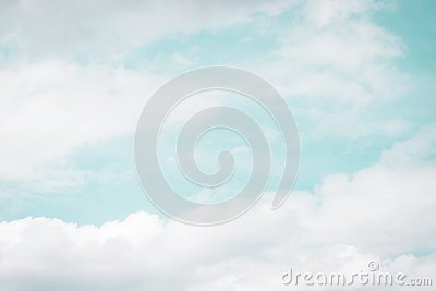 White clouds on the light blue aquamarine color sky background