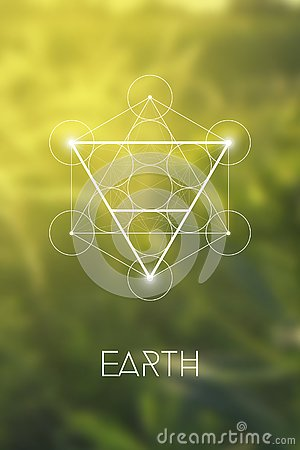 Sacred geometry Earth element symbol inside Metatron Cube and Flower of Life in front of natural blurry background