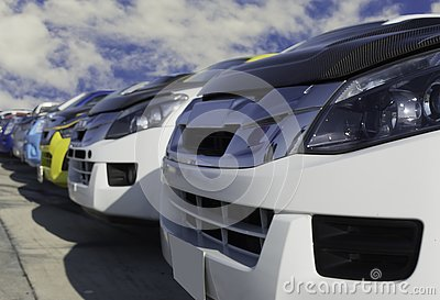 Used cars, parked in the parking lot of Dealership waiting to be sold and delivered to customers and waiting for the auction with