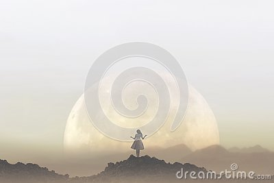Woman meditates in front of a giant moon