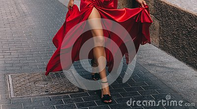 stock image of the girl in the red. long, slender legs