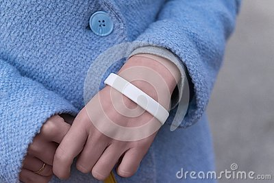 stock image of hands with white bracelet