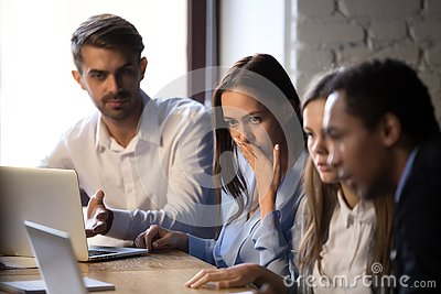 Surprised baffled diverse colleagues received bad news by email