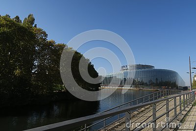 European Parliament in Strasburg on a sunny day, reflection in the river