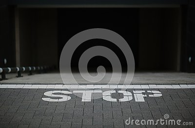 Sign stop on the ground